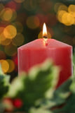 Large red candle burning bright Royalty Free Stock Image
