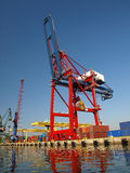 Large red container crane. At an industrial harbor in Gdansk, Poland Stock Photo