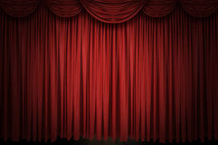 Large red curtain stage. Opening with spot lights and dark background Stock Image