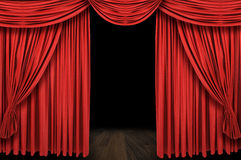 Large red curtain stage. Opening with dark background Royalty Free Stock Image