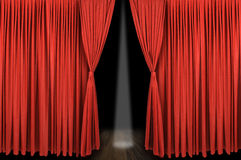 Large red curtain stage. Opening with dark background and spot light Stock Image