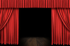 Large red curtain stage. Opening with dark background Stock Image