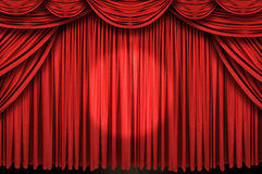 Large red curtain stage. With spot light Stock Photos