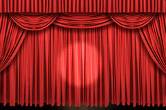 Large red curtain stage. With spot light Royalty Free Stock Image