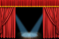 Large red curtain stage. Opening with spot lights and dark background Royalty Free Stock Photography