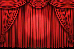 Large red curtain stage ans spot light. Large red curtain stage with spot light Royalty Free Stock Photo