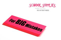 A large red eraser with message for big mistakes. School supplies. Large red eraser on a white background with text space. Needing a large eraser for really big stock photo