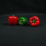 Large red and green bell pepper, vegetables arranged in series. Color Stock Image