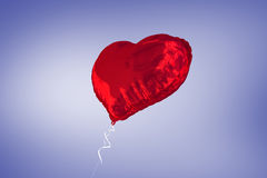 A large red heart balloon Stock Images