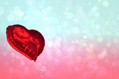 Large red heart shaped balloon Stock Image