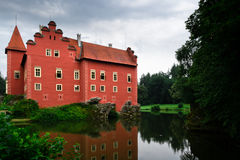 Large red house on lake Royalty Free Stock Photos