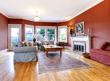 Large red living room and fireplace. Large nice living room with red walls and fireplace stock image