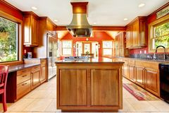 Large red luxury kitchen with wood and tiles. Royalty Free Stock Image