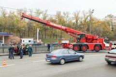 Rescue vehicle helps injured in car crash. Large red rescue vehicle helps injured in car crash stock illustration