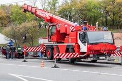 Rescue vehicle helps injured in car crash. Large red rescue vehicle helps injured in car crash vector illustration