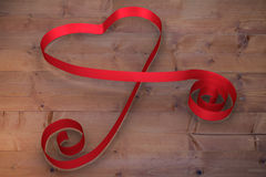 Large red ribbon in a heart shape Royalty Free Stock Photography