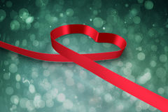 Large red ribbon in a heart shape Stock Photos