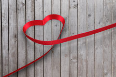 Large red ribbon in a heart shape Stock Photo
