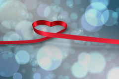 Large red ribbon in a heart shape Stock Images