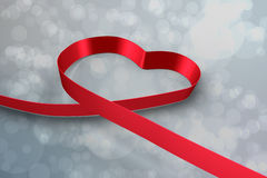 Large red ribbon in a heart shape Royalty Free Stock Image