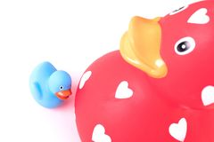 Large red rubber duck with a small duck stock images