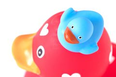 Large red rubber duck with a small duck stock photos