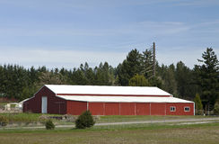 Large red warehouse rural Oregon. Stock Photos