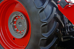 Large red wheel rim with rubber. Large red wheel rim, for machinery used in agriculture. Detail Stock Photography