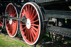 Large red wheels of the old classic trains on the rails. Stock Photos