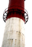 Factory chimney. Large red and white factory chimney royalty free stock photo