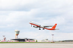 Large passenger airplane takes off at airport. Stock Photo