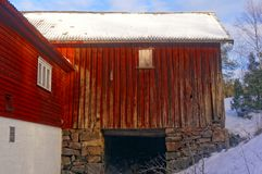 Large red wooden barn Stock Photos