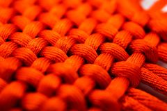Large red woven cords, texture, chinese new year, wallpaper, background. In macro. traditional chinese scarlet decoration royalty free stock image