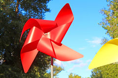 Large red and yellow children pinwheels. In the Natalka park, Kyiv, Ukraine Royalty Free Stock Photography