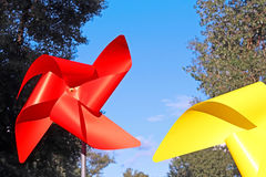 Large red and yellow children pinwheels. In the Natalka park, Kyiv, Ukraine Royalty Free Stock Images
