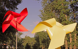 Large red and yellow children pinwheels. In the Natalka park, Kyiv, Ukraine.Vintage filter Stock Image