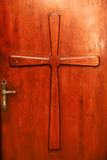 Cross Relief on a Door Royalty Free Stock Images