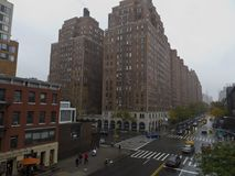 Large residential brick building structure in Manhattan New York. Humongous residential brick building structure in Manhattan New York on a rainy day Royalty Free Stock Image