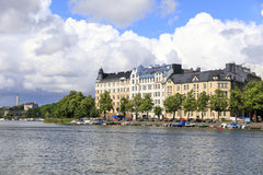 Large residential building with small harbor at river side. In Helsinki, Finland Stock Images