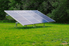 Large Residential Solar Panel. A large residential backyard solar panel sitting in the middle of a lawn Royalty Free Stock Image