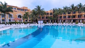 Large resort swimming pool in the tropics Royalty Free Stock Image