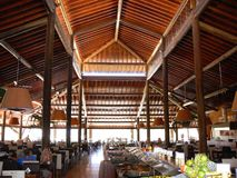 Large restaurant. Interior of a large, open hotel restaurant with a high, wooden ceiling Stock Photography