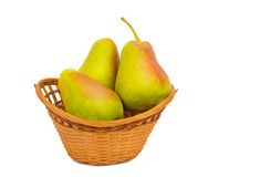 Large ripe pears in a wicker basket on a white background. Royalty Free Stock Images