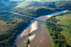Large River Bridge AirPhoto. Air Photo image overlooking a large river with its sand banks the farming landscape and long vehicle bridge Color photo image Royalty Free Stock Photos