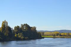 Large river landscape under blue skies. Large beautiful landscape o a large river under blue skies. autumn day in Valdivia, Chile Royalty Free Stock Images