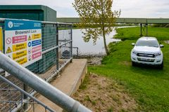 British Environment Agency vehicle seen near a riverbank system in the eats of England. This large river system is prone to flooding, the view shows not only Stock Photo