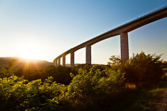 Large road bridge at sunset. Sunset over the high road bridge Royalty Free Stock Photography