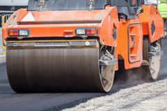 Large road-roller paving a road Royalty Free Stock Photography