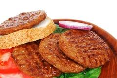 Large roast hamburger with loaf on wood Stock Image