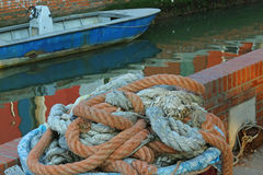 Large robust fishing ropes used by fishermen to moor the boat Stock Image